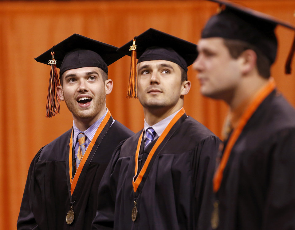 Students look up toward the audience as they enter Gallagher-Iba Arena. Undergraduates at OSU participated in the school's 127th commencement ceremony the weekend of Friday, May 3 and Saturday, May 4, 2013 inside Gallagher-Iba Arena on the university's campus.These photos were taken at the Saturday morning ceremony when students from the College of Agricultural Sciences and Natural Resources, and the Spears School of Business were conferred with degrees.   Photo  by Jim Beckel, The Oklahoman.