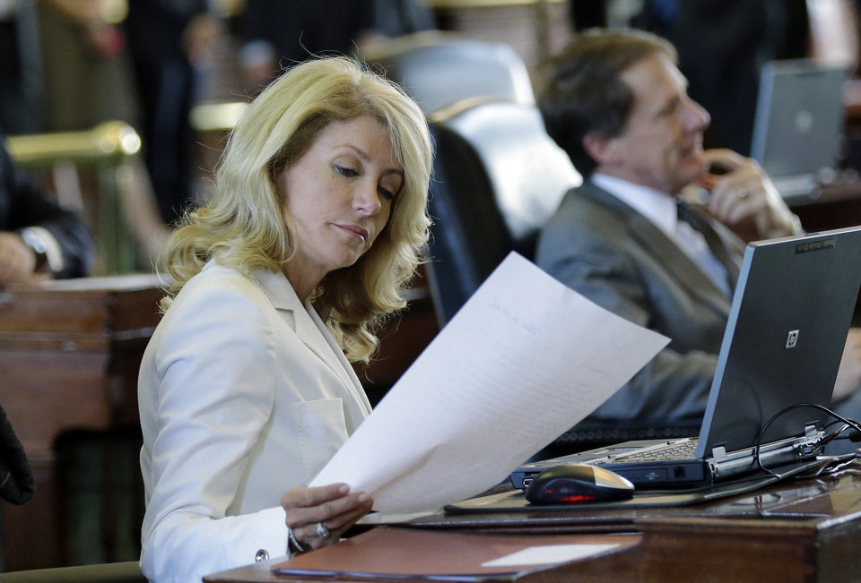 Sen. Wendy Davis, D-FortWorth, looks over papers in the Senate Chambers, Thursday, July 11, 2013, in Austin, Texas.  A Senate committee on Thursday pushed through new abortion restrictions, setting up a Senate vote before the weekend to send it to Gov. Rick Perry. The bill would require doctors to have admitting privileges at nearby hospitals, only allow abortions in surgical centers, dictate when abortion pills are taken and ban abortions after 20 weeks. (AP Photo/Eric Gay)