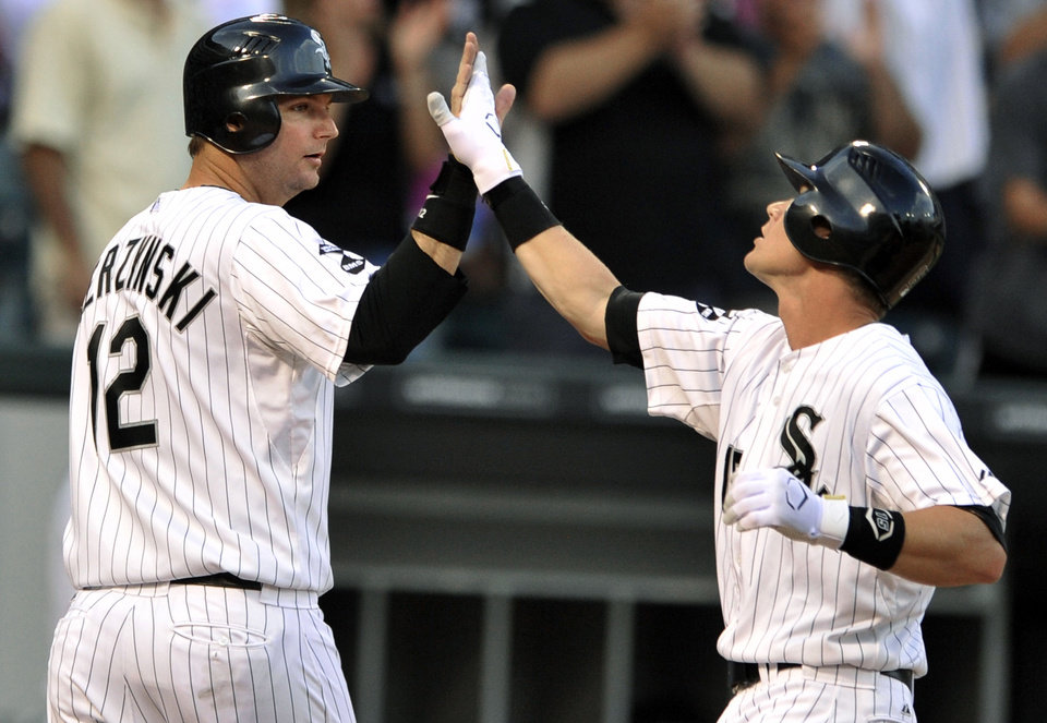 Photo -   Chicago White Sox's Gordon Beckham, right, celebrates with A.J. Pierzynski after hitting a two-run home run in the second inning of a baseball game against the Minnesota Twins in Chicago, Monday, Sept. 3, 2012. (AP Photo/Paul Beaty)