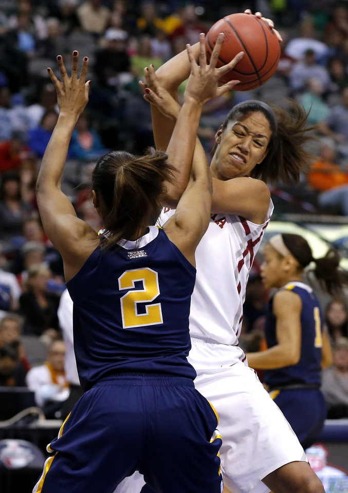 Oklahoma's Nicole Griffin tries to get past West Virginia's Akilah Bethel during the Big 12 tournament women's college basketball game between the University of Oklahoma and West Virginia at American Airlines Arena in Dallas, Saturday, March 9, 2012. Photo by Bryan Terry, The Oklahoman