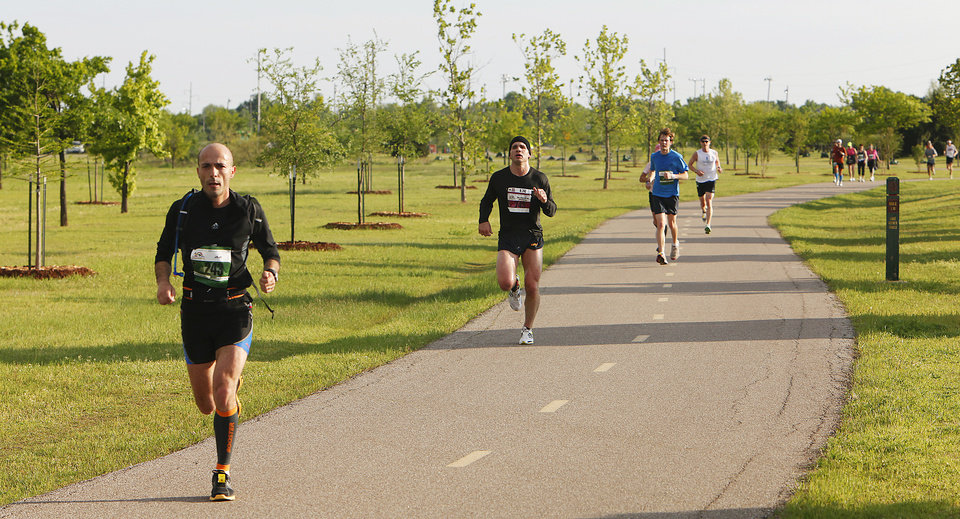 Photo - Runners on the Lake Hefner trail south of Britton during the Tenth Annual Oklahoma City Memorial Marathon, Sunday, April 25, 2010.   Photo by David McDaniel, The Oklahoman ORG XMIT: KOD