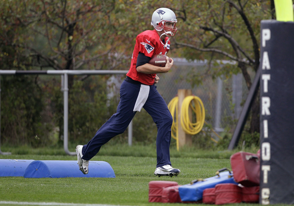 Photo -   New England Patriots quarterback Tom Brady (12) runs a drill during practice at the NFL football team's facility in Foxborough, Mass., Wednesday, Oct. 3, 2012. (AP Photo/Stephan Savoia)