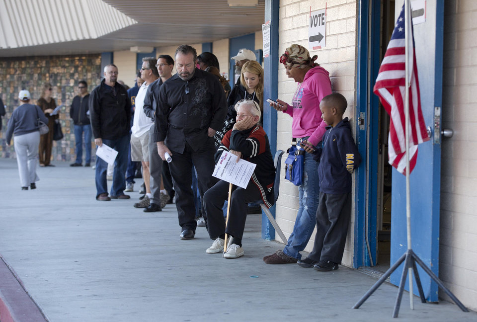 Photo -   A line forms outside a polling place as people gather to vote on Election Day Tuesday, Nov. 6, 2012, in Las Vegas. (AP Photo/Julie Jacobson)