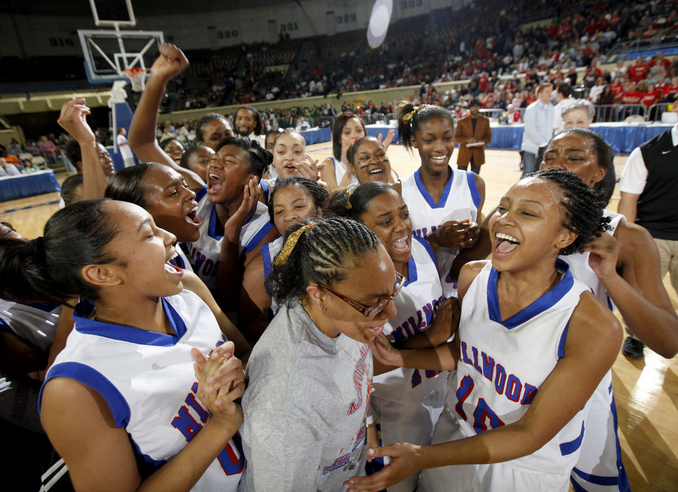 The Millwood team celebrates following their 64-50 win over Prague in the Class 3A girls high school state basketball championship game at State Fair Arena in Oklahoma City, Saturday, March 10, 2012. Photo by Bryan Terry, The Oklahoman