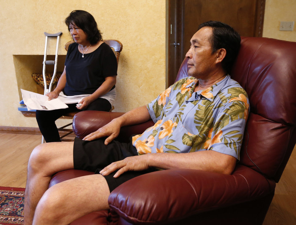 Photo -  Rany Kchao, owner of Whispering Pines, and wife Thavory Kchao talk Wednesday about the FBI investigation into his Norman bed-and-breakfast and allegations they kept a Cambodian woman as an indentured servant. [Photo by Steve Sisney, The Oklahoman]