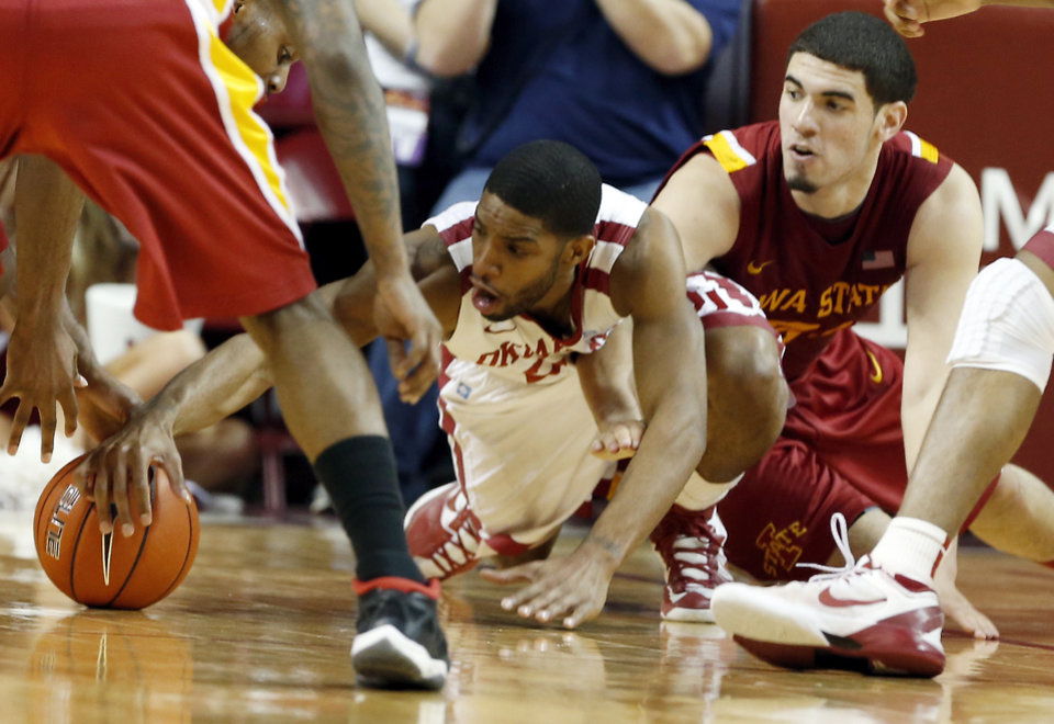 Photo - Oklahoma's Cameron Clark (21) dives for a loose ball in the second half as the University of Oklahoma Sooners (OU) men defeat the Iowa State Cyclones 86-69 in NCAA, college basketball at Lloyd Noble Center on Saturday, March 2, 2013  in Norman, Okla. Photo by Steve Sisney, The Oklahoman