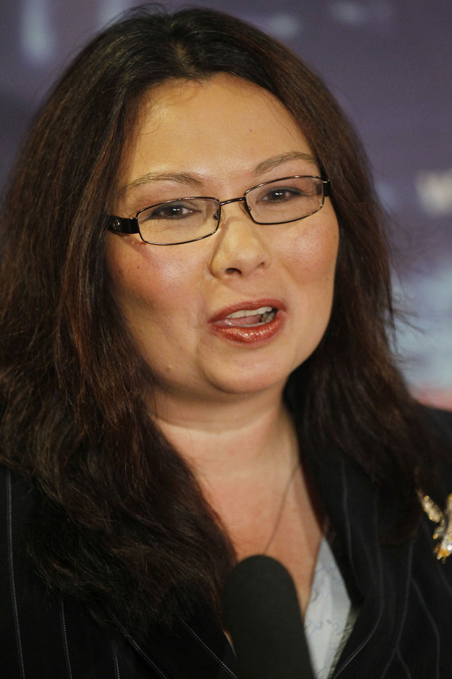 Photo -   ADVANCE FOR SUNDAY OCT. 28 - In this Oct. 17, 2012 photo, Democrat Tammy Duckworth speaks after her debate with Republican incumbent U.S. Rep Joe Walsh in Chicago. They are running for Illinois' 8th Congressional District seat in the Nov. 6 election. (AP Photo/Charles Rex Arbogast)