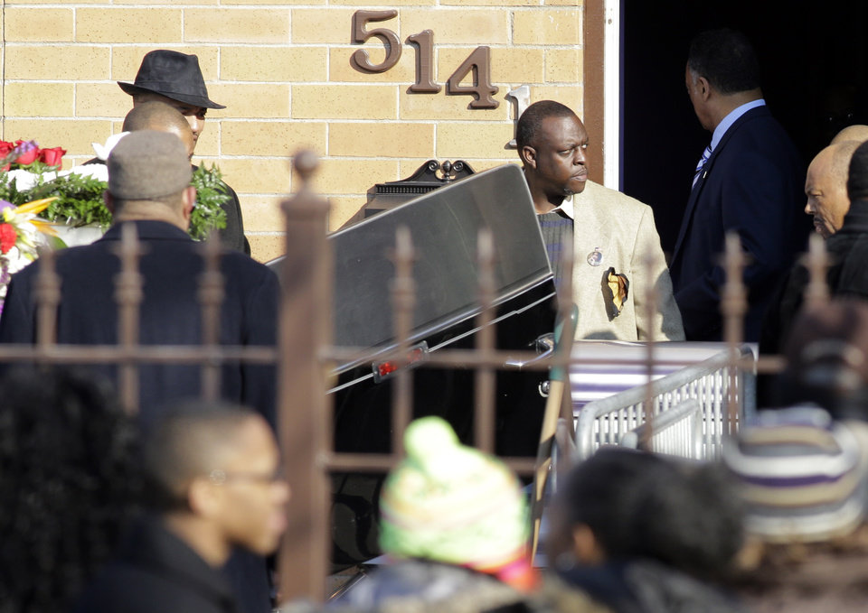 A casket holding the body of Hadiya Pendleton is moved to a hearse after her funeral at the Greater Harvest Missionary Baptist Church on Saturday, Feb. 9, 2013, in Chicago. Hundreds of mourners and dignitaries including first lady Michelle Obama packed the funeral service Saturday for a Chicago teen whose killing catapulted her into the nation's debate over gun violence. (AP Photo/Nam Y. Huh)