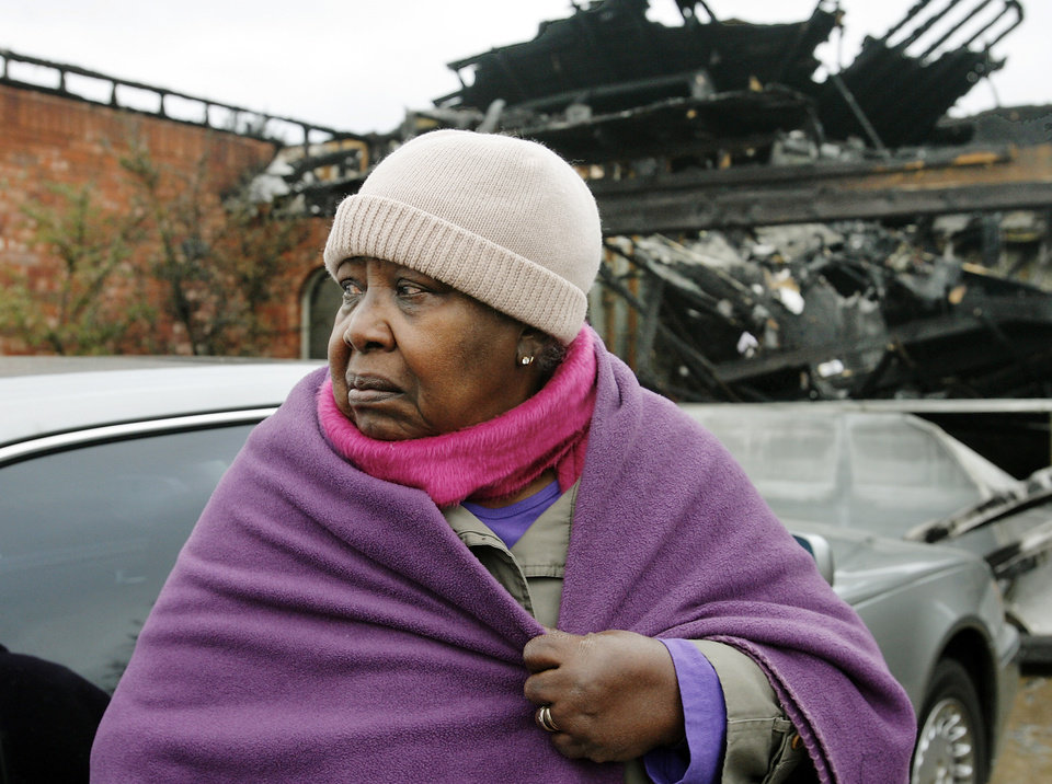 Photo - A teary-eyed Ethel McCarty surveys damage to her daughter's home in the Oakwood East Royale neighborhood Friday morning, April 10, 2009. Friends and relatives of Nathan and Sammetra Christman converged at their home at 2040  Westbury Street to help the Christmans collect personal belongings that could be salvaged. The Christman home was one of dozens  destroyed in Thursday's wildfires. Photo by Jim Beckel, The Oklahoman