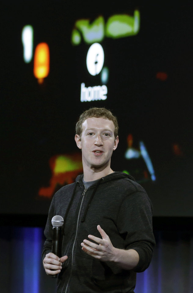 Photo - Facebook CEO Mark Zuckerberg speaks at the company's headquarters in Menlo Park, Calif., Thursday, April 4, 2013. Zuckerberg says the company is not building a phone or an operating system. Rather, Facebook is introducing  a new experience for Android phones. The idea behind the new Home service is to bring content right to you, rather than require people to check apps on the device.   (AP Photo/Marcio Jose Sanchez)