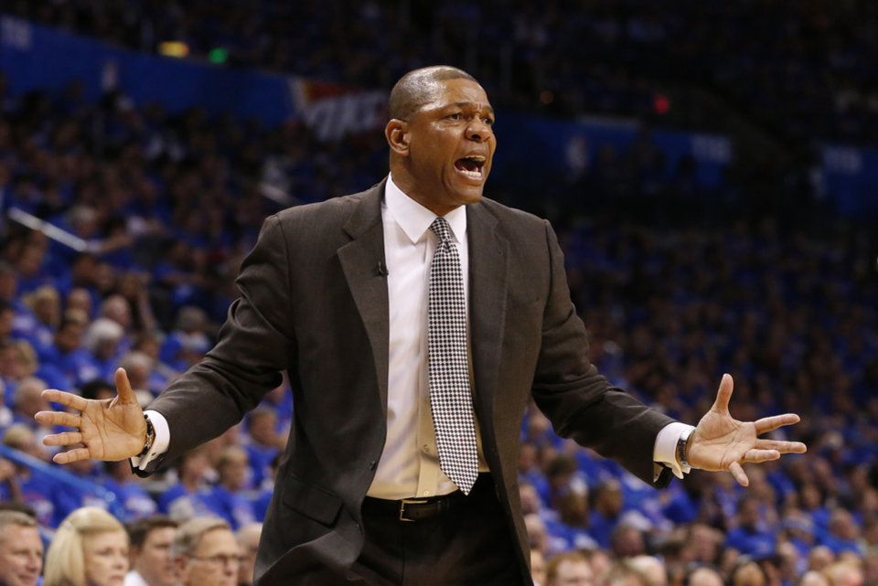 Photo - Los Angeles Clippers head coach Doc Rivers gestures in the third quarter of Game 1 of the Western Conference semifinal NBA basketball playoff series in Oklahoma City, Monday, May 5, 2014. Los Angeles won 122-105. (AP Photo/Sue Ogrocki)
