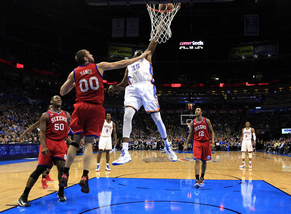 Oklahoma City's Kevin Durant (35) dunks in front of Philadelphia's Spencer Hawes (00) and Lavoy Allen (50) during the NBA game between the Oklahoma City Thunder and the Philadelphia 76ers at the Chesapeake Energy Arena in Oklahoma City, Saturday,Jan. 5, 2013. Photo by Sarah Phipps, The Oklahoman