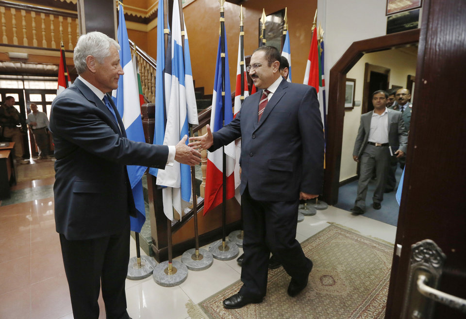 Photo - U.S. Secretary of Defense Chuck Hagel, left, meets with Afghanistan's Interior Minister Ghulam Mujtaba Patang at the ISAF (International Security Assistance Force) headquarters in Kabul, Sunday, March 10, 2013. It is Hagel's first official trip since being sworn-in as Obama's Defense Secretary. (AP Photo/Jason Reed, Pool)