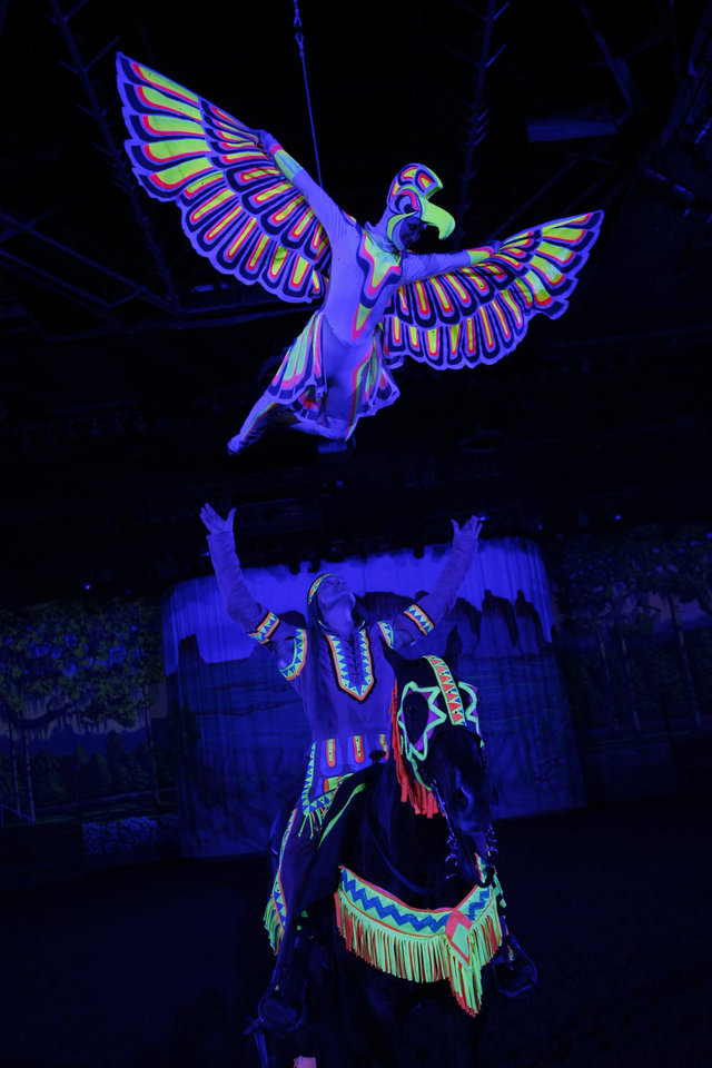 Photo - An aerial dancer depicts an eagle during the American Indian portion of the Dixie Stampede show. Photo provided by Dolly Parton's Dixie Stampede.
