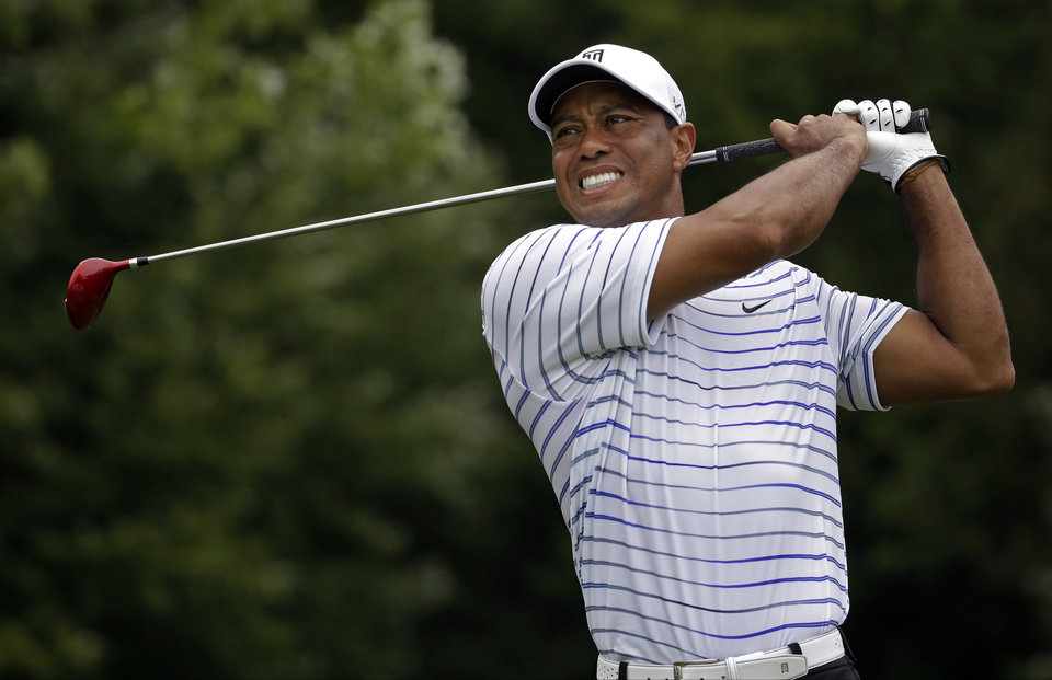 Photo - Tiger Woods winces after tee shot on the sixth hole during the second round of the PGA Championship golf tournament at Valhalla Golf Club on Friday, Aug. 8, 2014, in Louisville, Ky. (AP Photo/Jeff Roberson)