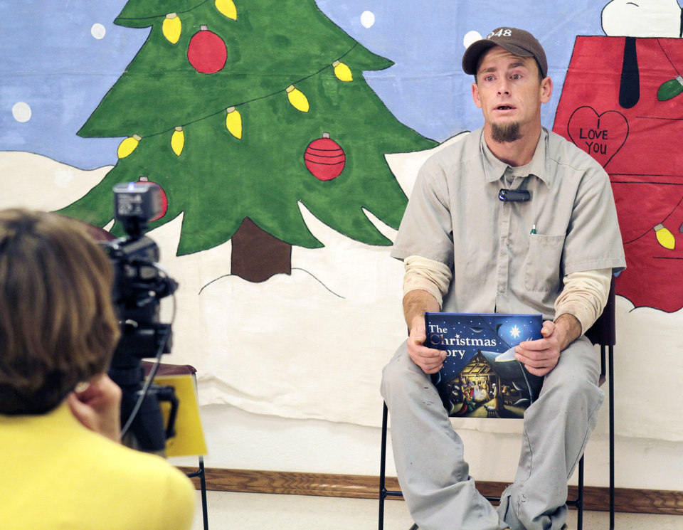 Inmate Andrew Smalle talks to his children on video, as the Oklahoma Message Project videotapes the Christmas messages of incarcerated men at Clara Waters CCC in Oklahoma City, OK, Tuesday, Dec. 13, 2011. By Paul Hellstern, The Oklahoman