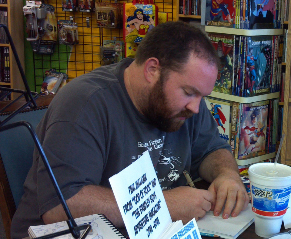 Artist Paul Milligan sketches at a local comics shop. Photo by Annette Price, for The Oklahoman. <strong></strong>