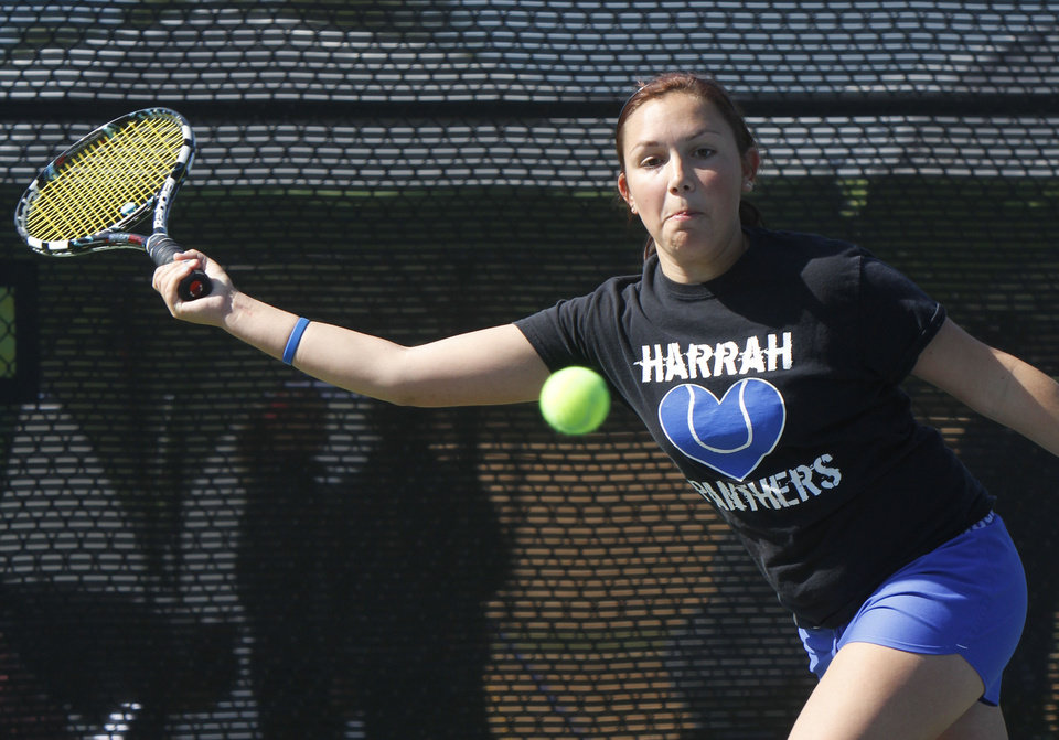 Photo - CLASS 5A GIRLS HIGH SCHOOL TENNIS / STATE TOURNAMENT: Lainey Canfield of Harrah returns the ball to opponent Shay Hurta of Tecumseh during the 5A Girls State Tennis tournament at the OKC Tennis Center in Oklahoma City, OK, Friday, May 3, 2013,  By Paul Hellstern, The Oklahoman