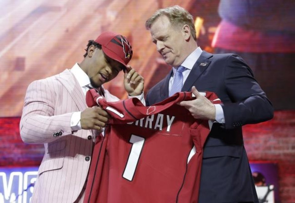 Photo -  Oklahoma quarterback Kyler Murray poses with NFL Commissioner Roger Goodell after the Arizona Cardinals selected Murray first overall in the draft Thursday in Nashville, Tenn. [AP Photo/Mark Humphrey]