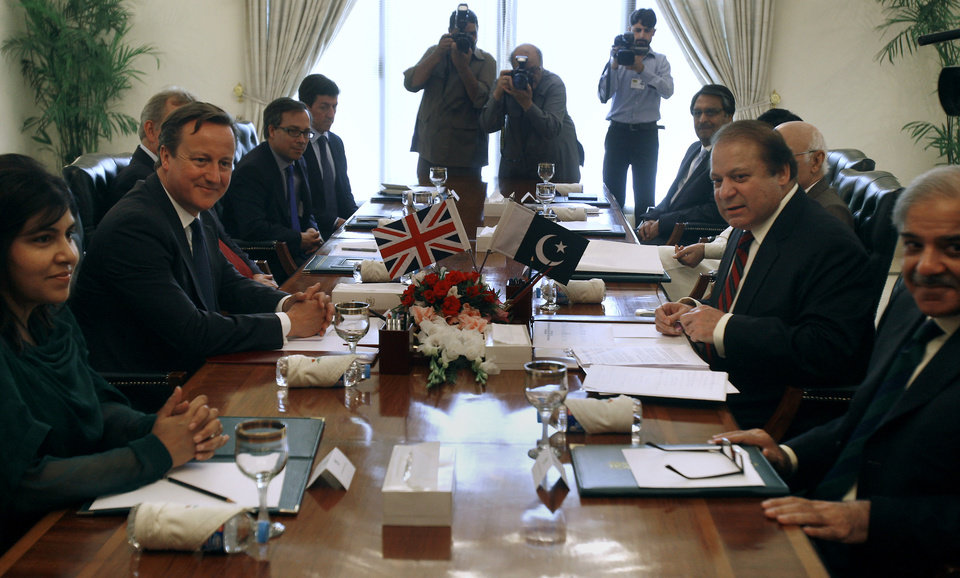 Photo - British Prime Minister David Cameron, second left, holds talks with his Pakistani counterpart Nawaz Sharif, second right, Sunday, June 30, 2013 in Islamabad, Pakistan. Cameron is in Islamabad on a tow-day visit to hold talks with Pakistani top leaders on bilateral interest, regional and international importance including the peace process in Afghanistan. (AP Photo/Anjum Naveed)