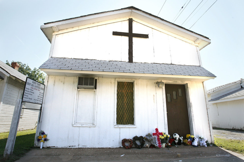 Flowers and stuffed animals and mementos are seen in this 2009 photo at the entrance of a church where the Rev. Carol Daniels, seen above right, was killed in Anadarko. ARCHIVE PHOTO By Steve Sisney, The Oklahoman