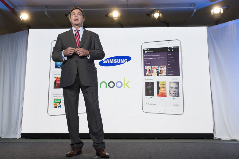 Photo - Mike Huseby, CEO of Barnes & Noble, speaks during the unveiling of the Samsung Galaxy Tab 4 Nook, a tablet that will replace B&N's Nook, Wednesday, Aug. 20, 2014, in New York. The 7-inch tablet will sell for $179 after a $20 instant rebate, the same entry price of the non-branded Samsung Galaxy Tab 4. (AP Photo/John Minchillo)