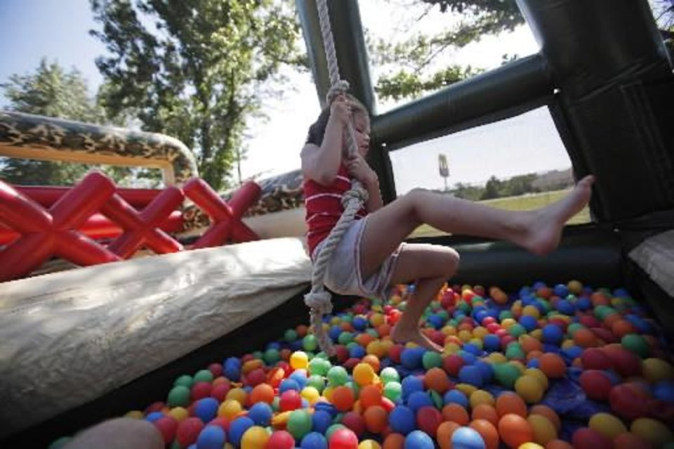 Photo - Brooklyn Bryan, 5, of Seminole, goes through an obstacle course at a Fourth of July Celebration in Seminole, Okla., July 4, 2012. Photo by Garett Fisbeck, The Oklahoman