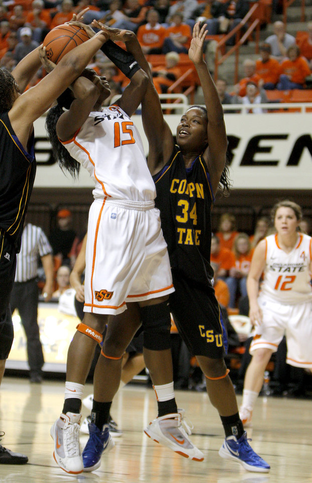 Photo - Oklahoma State's Toni Young (15) shoots over Coppin State's Larrisa Carter (34) during the women's college game between Oklahoma State University and Coppin State at Gallagher-Iba Arena in Stillwater, Okla.,  Saturday, Nov. 26, 2011.  Photo by Sarah Phipps, The Oklahoman