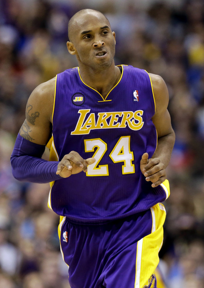Los Angeles Lakers' Kobe Bryant (24) looks toward the bench after scoring a 3-pointer against the Dallas Mavericks late in the second half of an NBA basketball game, Sunday, Feb. 24, 2013, in Dallas. Bryant scored 38-points in their 103-99 win. (AP Photo/Tony Gutierrez)