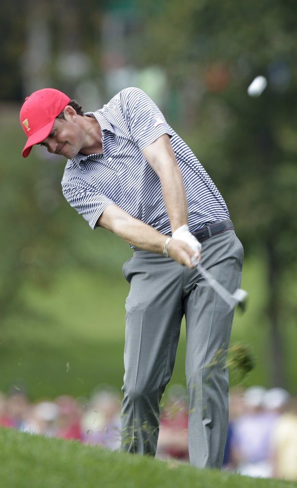 Photo - United States' Keegan Bradley hits his approach shot on the first hole during a foursome match against the International team at the Presidents Cup golf tournament at Muirfield Village Golf Club Friday, Oct. 4, 2013, in Dublin, Ohio. (AP Photo/Jay LaPrete)