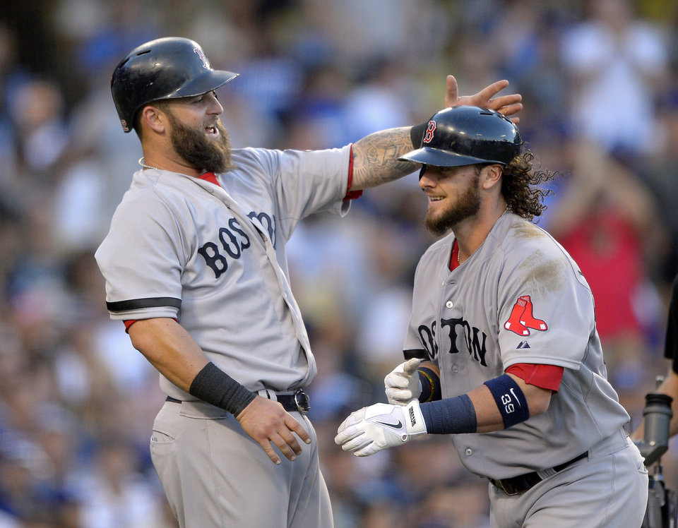 Photo - Boston Red Sox's Jarrod Saltalamacchia, right, is congratulated by Mike Napoli after hitting a two-run home run during the sixth inning of their baseball game against the Boston Red Sox, Sunday, Aug. 25, 2013, in Los Angeles.  (AP Photo/Mark J. Terrill)