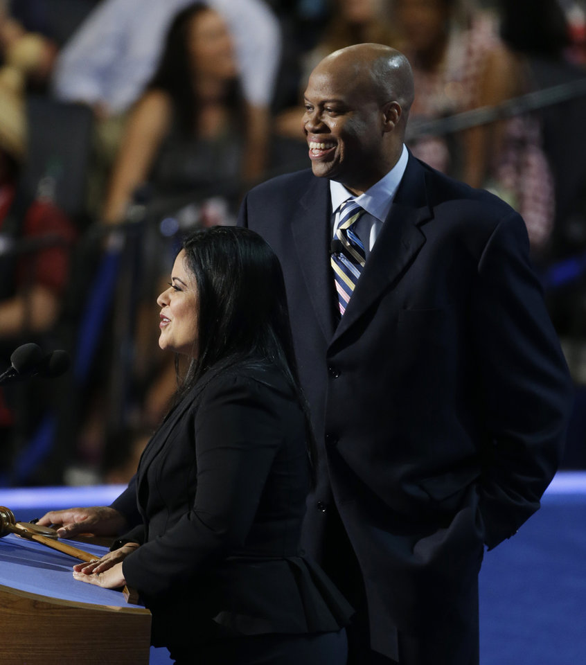 Photo - Maya Soetoro-ng, President Barack Obama's sister, and Craig Robinson, First Lady Michelle Obama's brother, speak at the Democratic National Convention in Charlotte, N.C., on Tuesday, Sept. 4, 2012. (AP Photo/Lynne Sladky)  ORG XMIT: DNC493