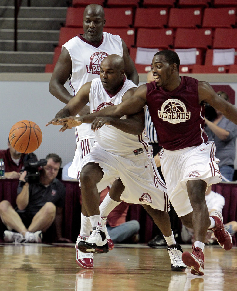 Terry Evans, center, and Sam Grooms go for the ball as Roland Ware looks on as the University of Oklahoma Sooners (OU) basketball alumni play at The Lloyd Noble Center on Saturday, Aug. 24, 2013  in Norman, Okla. Photo by Steve Sisney, The Oklahoman