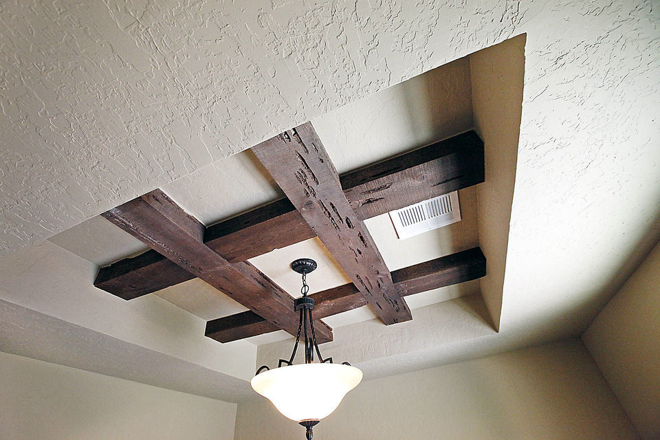 Photo - Exposed beams give a rustic look to the study of the R&R Homes project house at 1105 Dayton Lane in Moore's Rock Creek addition. The home and 28 others will be open free to the public from 1 to 7 p.m. Saturday and Sunday.  David McDaniel - The Oklahoman
