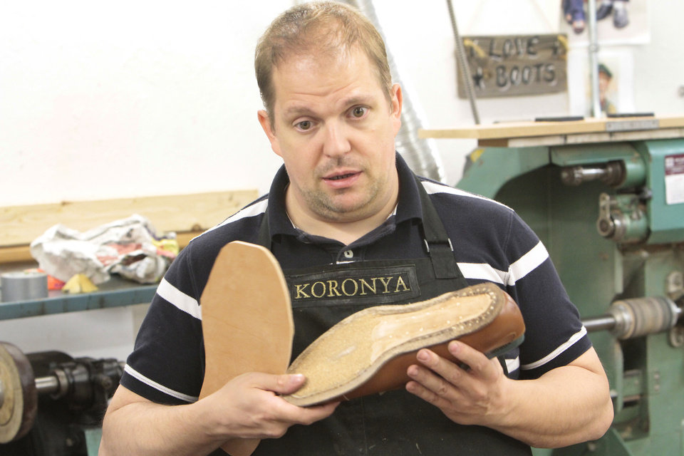 Photo - Hungarian shoemaker Marcell Mrsán is visiting Sorrell Custom Boots in Guthrie this week to teach students his trade, Thursday, July 19 , 2012. Photo By David McDaniel/The Oklahoman  David McDaniel - The Oklahoman