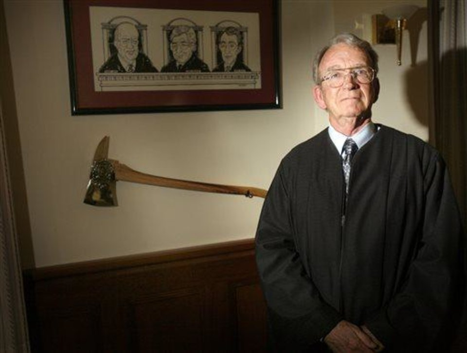 Photo - File-This photo taken July 16, 2008 shows Federal Appellate Court Judge Paul  J. Kelly.  Kelly, was in the minority in his opinion as the two other judges on the 10th Circuit Court of Appeals panel found the U.S. Constitution protects the rights of gay couples to marry. Kelly has broken the string of 16 state and federal judges who sided with gay marriage advocates in cases across the country over the past year. (AP Photo/The Santa Fe New Mexican, Natalie Guillen)