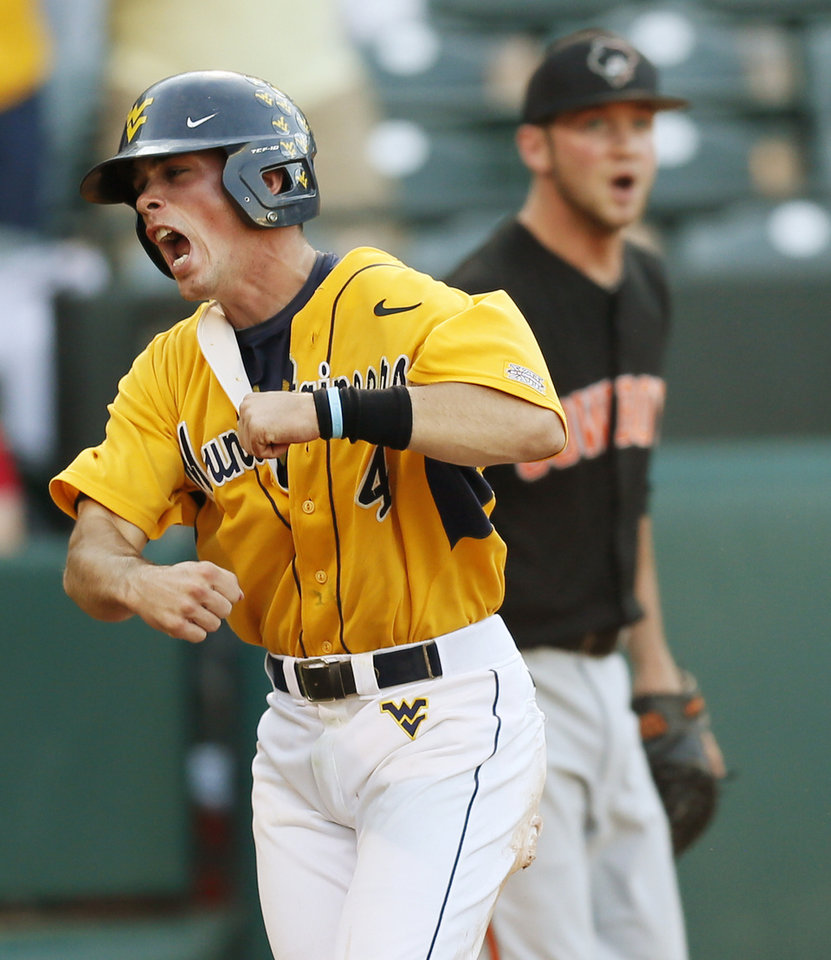 West Virginia\'s Bobby Boyd (4) reacts in front of Oklahoma State pitcher Brendan McCurry (4) after scoring the winning run in the tenth inning during an NCAA baseball game between Oklahoma State and West Virginia in the Big 12 Baseball Championship tournament at the Chickasaw Bricktown Ballpark in Oklahoma City, Saturday, May 25, 2013. WVU beat OSU 6-5 in ten innings. Photo by Nate Billings, The Oklahoman