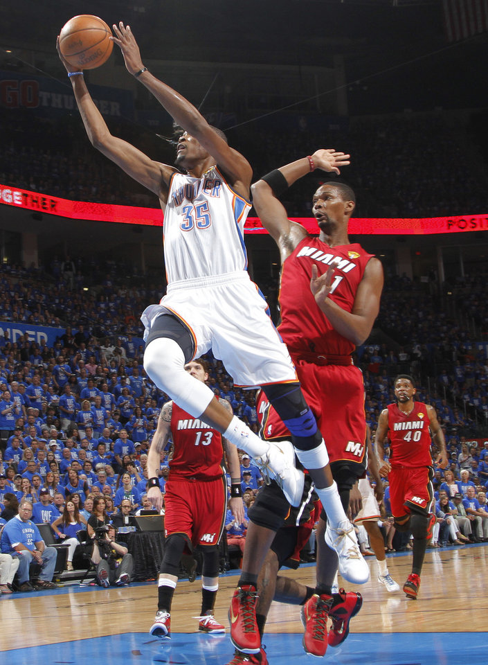 Oklahoma City 's Kevin Durant (35) drives past Miami's Chris Bosh (1) during Game 1 of the NBA Finals between the Oklahoma City Thunder and the Miami Heat at Chesapeake Energy Arena in Oklahoma City, Tuesday, June 12, 2012. Photo by Chris Landsberger, The Oklahoman