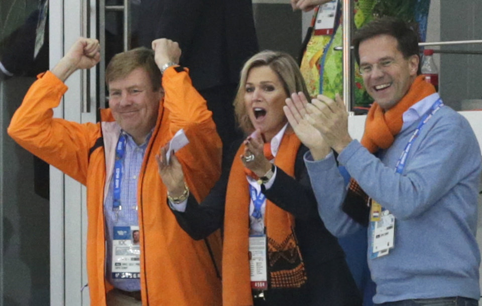 Photo - Dutch King Wilem-Alexander, left, Queen Maxima and Prime Minister Mark Rutte celebrate as country skater Sven Kramer sets a new Olympic record for the men's 5,000-meter speedskating race at the Adler Arena Skating Center at the 2014 Winter Olympics in Sochi, Russia, Saturday, Feb. 8, 2014. (AP Photo/Matt Dunham)