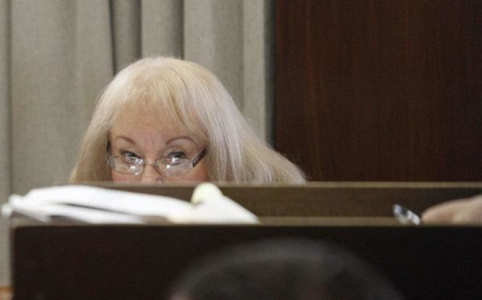 Photo - Former Sen. Debbe Leftwich watches legal arguments during her preliminary hearing Friday.  The Oklahoman - Steve Gooch