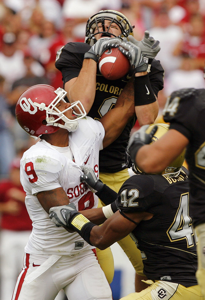 Photo - Colorado's Daniel Dykes (9) pulls in an interception on a pass to Oklahoma's Juaquin Iglesias (9) during the second half of the college football game between the University of Oklahoma Sooners (OU) and the University of Colorado Buffaloes (CU) at Folsom Field on Saturday, Sept. 29, 2007, in Boulder, Co. The play led to a touchdown that tied the game for Colorado.  By CHRIS LANDSBERGER, The Oklahoman  ORG XMIT: KOD
