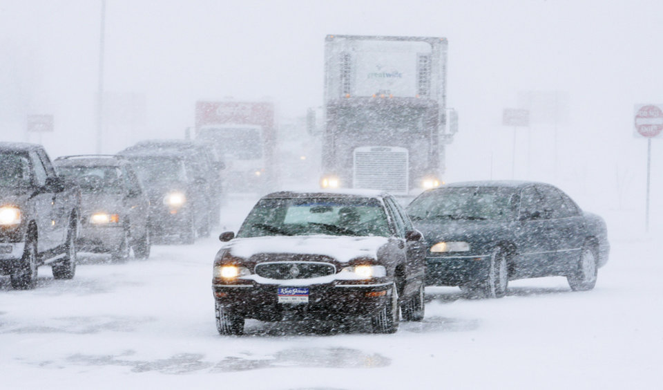 Photo - Blowing snow backs up traffic Thursday northbound on State Highway 81 in El Reno after the closure of Interstate 40.  Photo by Paul B. Southerland, The Oklahoman