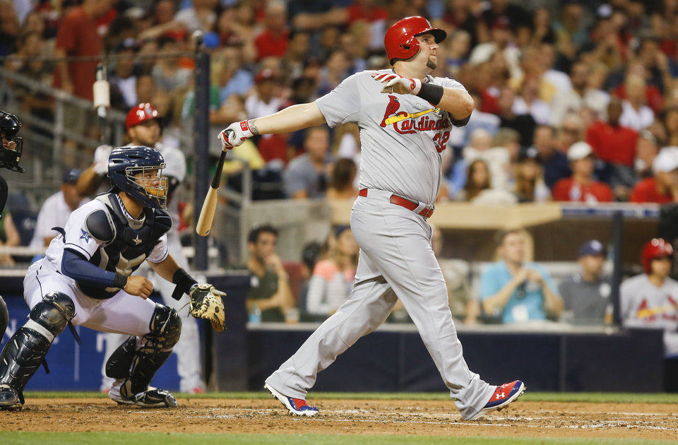 Photo - St. Louis Cardinals' Matt Adams watches his deep drive against the San Diego Padres with two runners on base in the third inning of a baseball game Tuesday, July 29, 2014, in San Diego. The ball came up just short for a long out.  (AP Photo/Lenny Ignelzi)