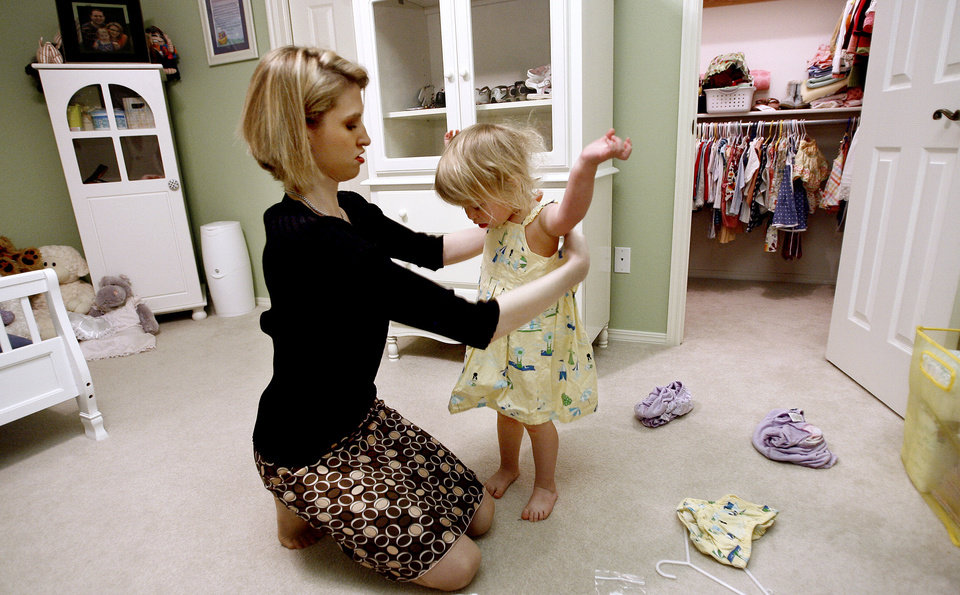 SECOND PLACE, WEB PHOTO: Tonya Ratcliff dresses her daughter Elliott, 2, in the morning Wednesday, April 23, 2008, in Oklahoma City. BY SARAH PHIPPS, THE OKLAHOMAN