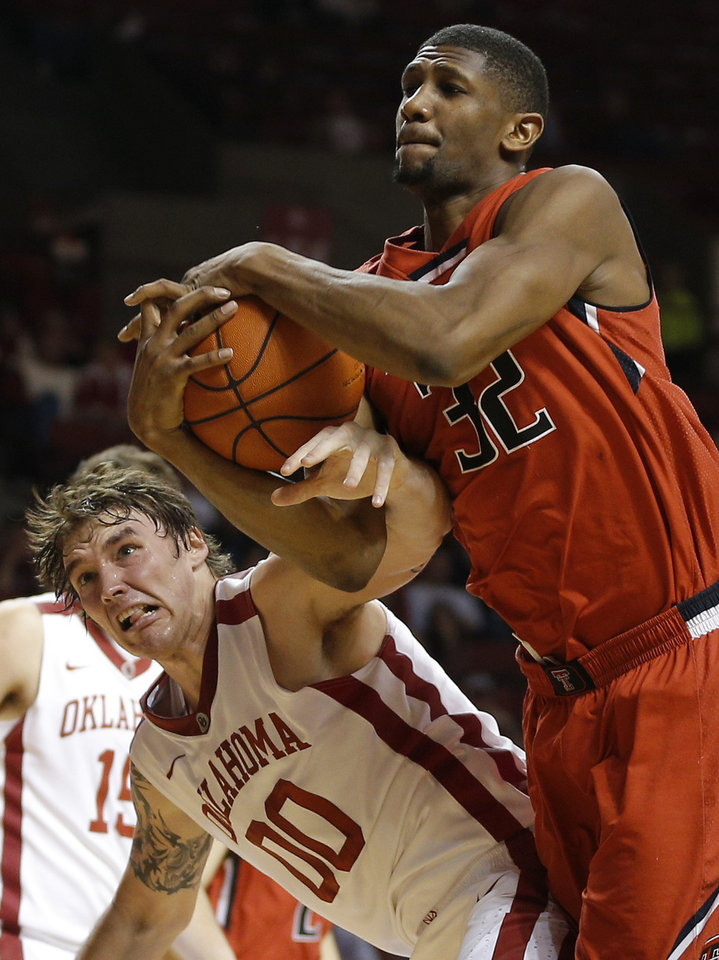 Photo - Texas Tech's Jordan Tolbert (32) grabs a rebound over Oklahoma's Ryan Spangler (00) during an NCAA college basketball game between the University of Oklahoma and Texas Tech University at the Lloyd Noble Center in Norman, Okla., Wednesday, Feb. 12, 2014. Photo by Bryan Terry, The Oklahoman