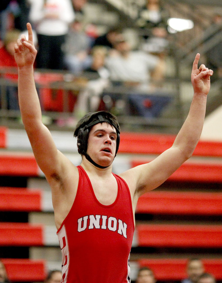 Union\'s Chance Wenglewski celebrates his win in the 6A 220-pound class during the finals of the State dual wrestling championship at Yukon High School in Yukon, Okla., Saturday, Feb. 11, 2012. Photo by Sarah Phipps, The Oklahoman