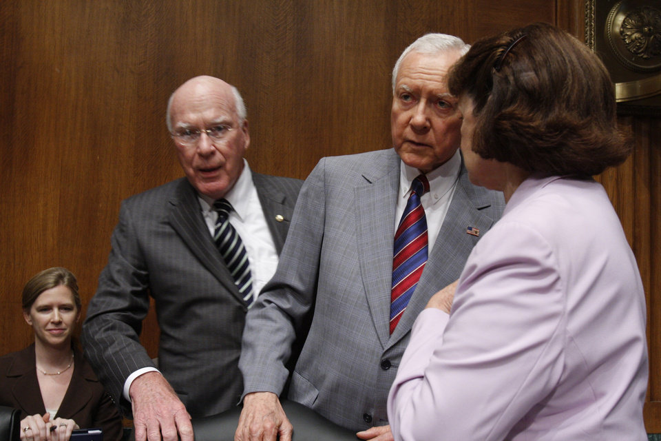 Senate Judiciary Committee members, from left, chairman Sen. Patrick Leahy, D-Vt., Sen. Orrin Hatch, R-Utah, and Sen. Dianne Feinstein, D-Calif., confer on Capitol Hill in Washington, Thursday, June 25, 2009, before the committee\'s hearing on hate crime legislation. (AP Photo/Harry Hamburg) ORG XMIT: DCHH117