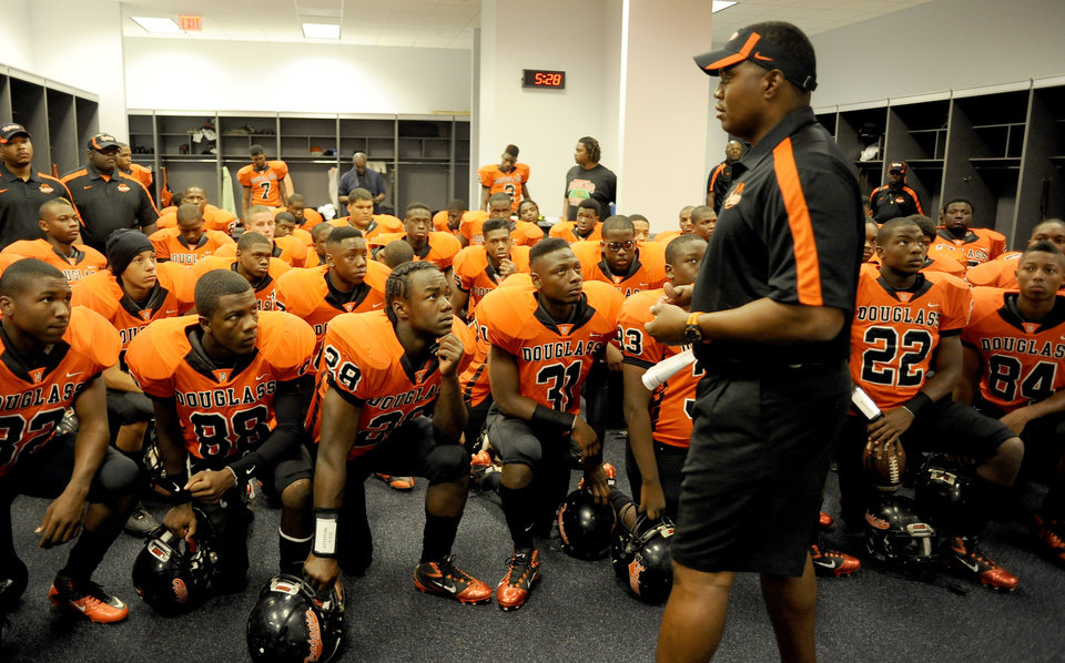 Photo - Douglass head coach Willis Alexander talks to his team in the locker room before the high school football game between Douglass and DeSoto, Monday, Sept. 5, 2011, at Cowboys Stadium in Arlington, Texas. (Matt Strasen/Special Contributor) ORG XMIT: KOD