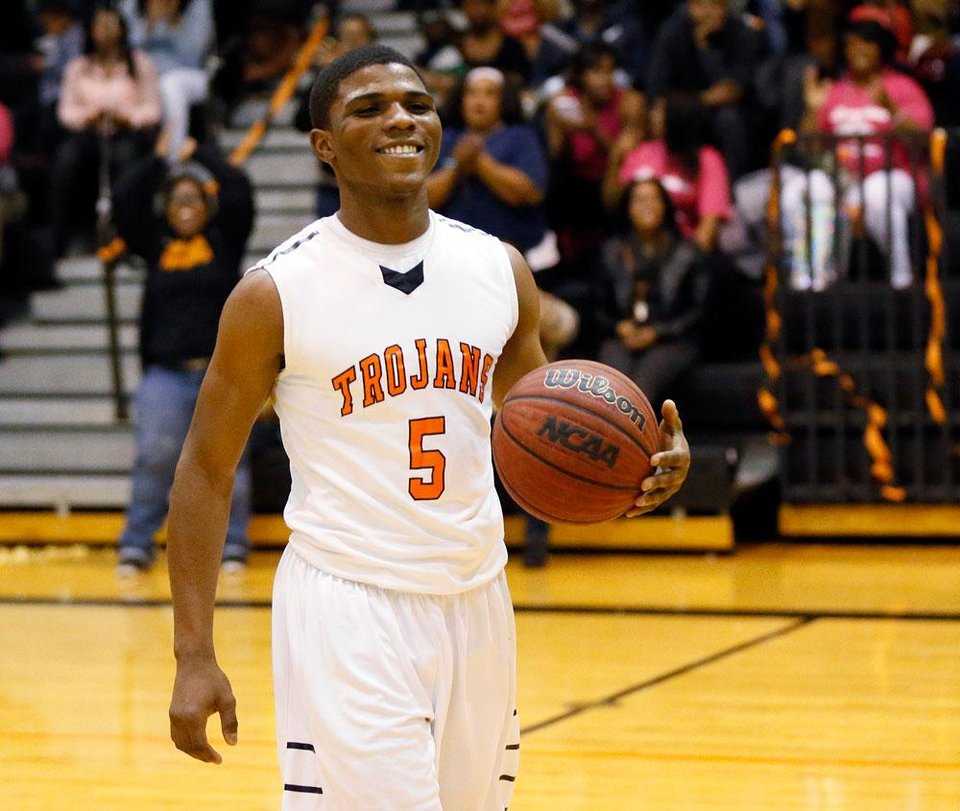 Photo -  Douglass' Stephen Clark (5) smiles as he is recognized for scoring the 3,000th point of his career during a boys high school basketball game between Douglass and Northeast at Douglass High School in Oklahoma City, Friday, Feb. 8, 2013. Photo by Nate Billings, The Oklahoman