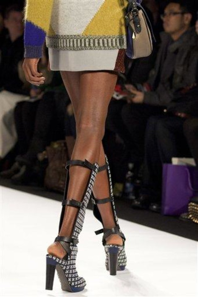 FILE - This Feb. 8, 2013 file photo shows a model wearing high boots during the Rebecca Minkoff Fall 2013 fashion show during Fashion Week in New York. As New York Fashion Week's fall previews wrapped up Thursday, designers didn't ignore the feet. (AP Photo/Karly Domb Sadof, file)